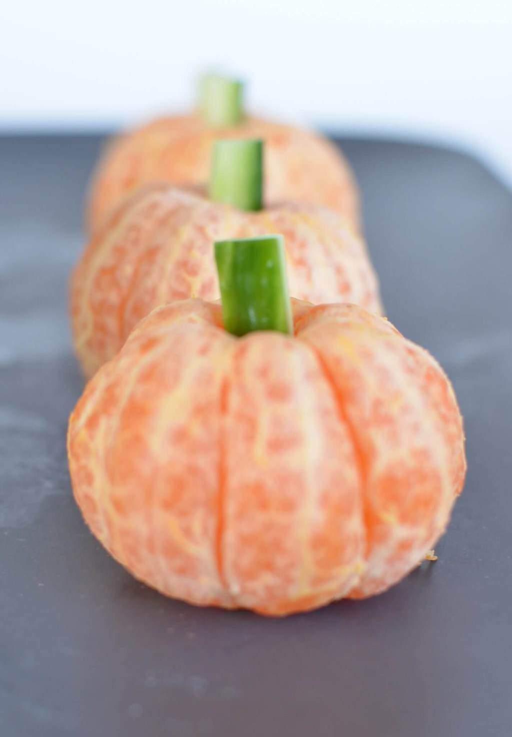 Healthy halloween treats with fun pumpkins made from mandarins