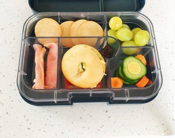 A Fun Kids Lunch Box With A Round Theme
