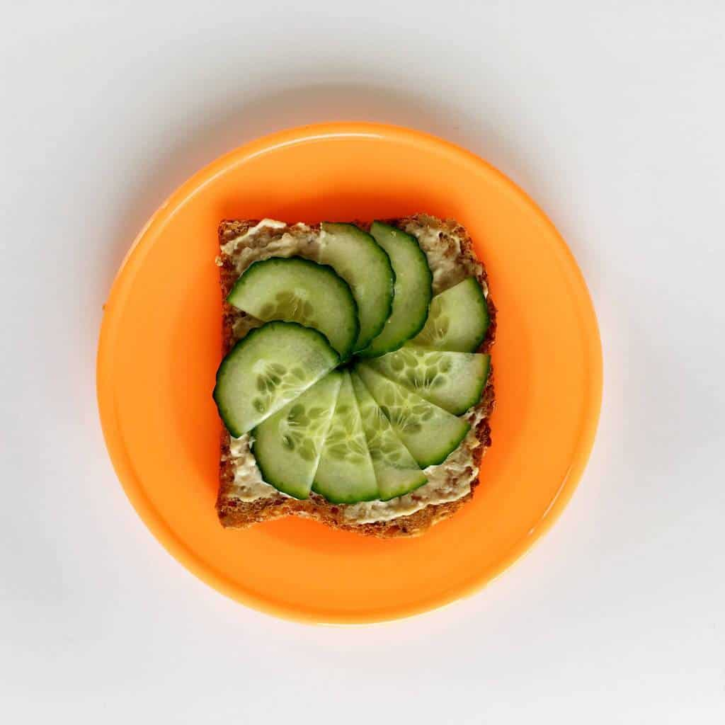 Healthy toast topping ideas for children, hummus and cucumber