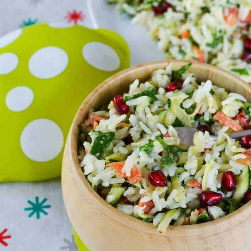 Christmas rice salad recipe. The colours scream Christmas and its chopped salad style makes it kid friendly too. Served in a Haakaa wooden mushroom bowl