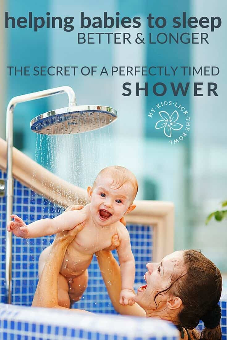 Baby being held in shower by mother