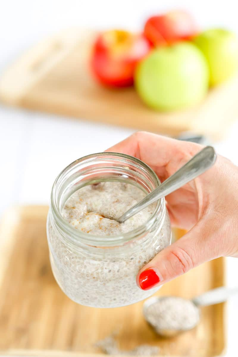 Hand holding a jar of chia pudding