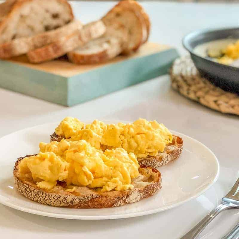Easy cheesy scrambled eggs recipe uses your blender to make the best fluffy scrambled eggs