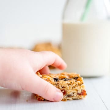 Easy oat slice, child's hand reaching to pick up a piece