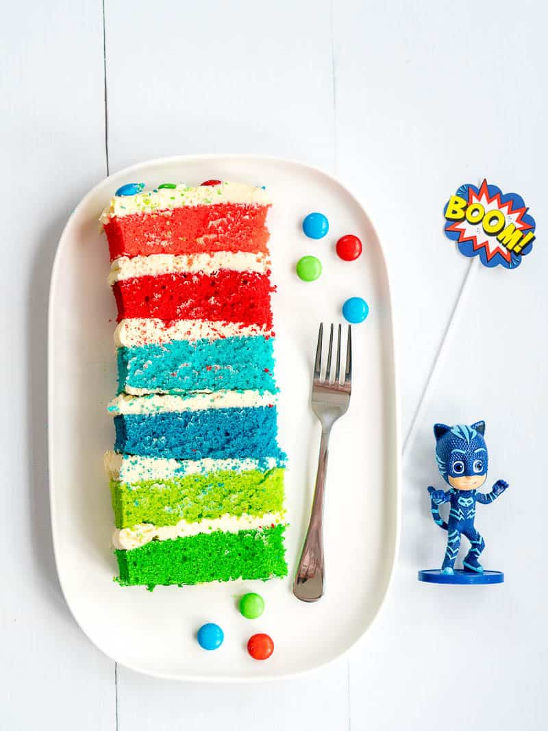 PJ masks rainbow layered birthday cake, piece on a plate