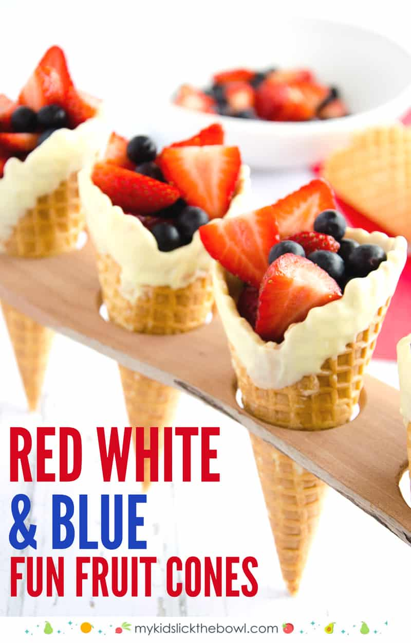 Red white and blue cones, ice cream cones in a wooden rack filled with red and blue berries
