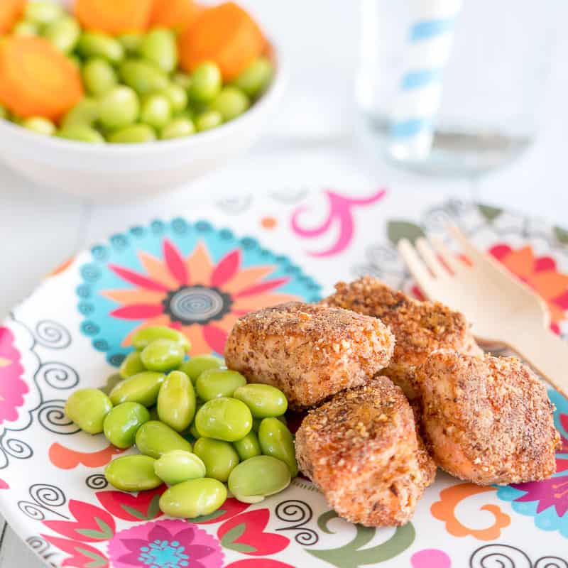 baked salmon bites with edamame beans on a colourful plate