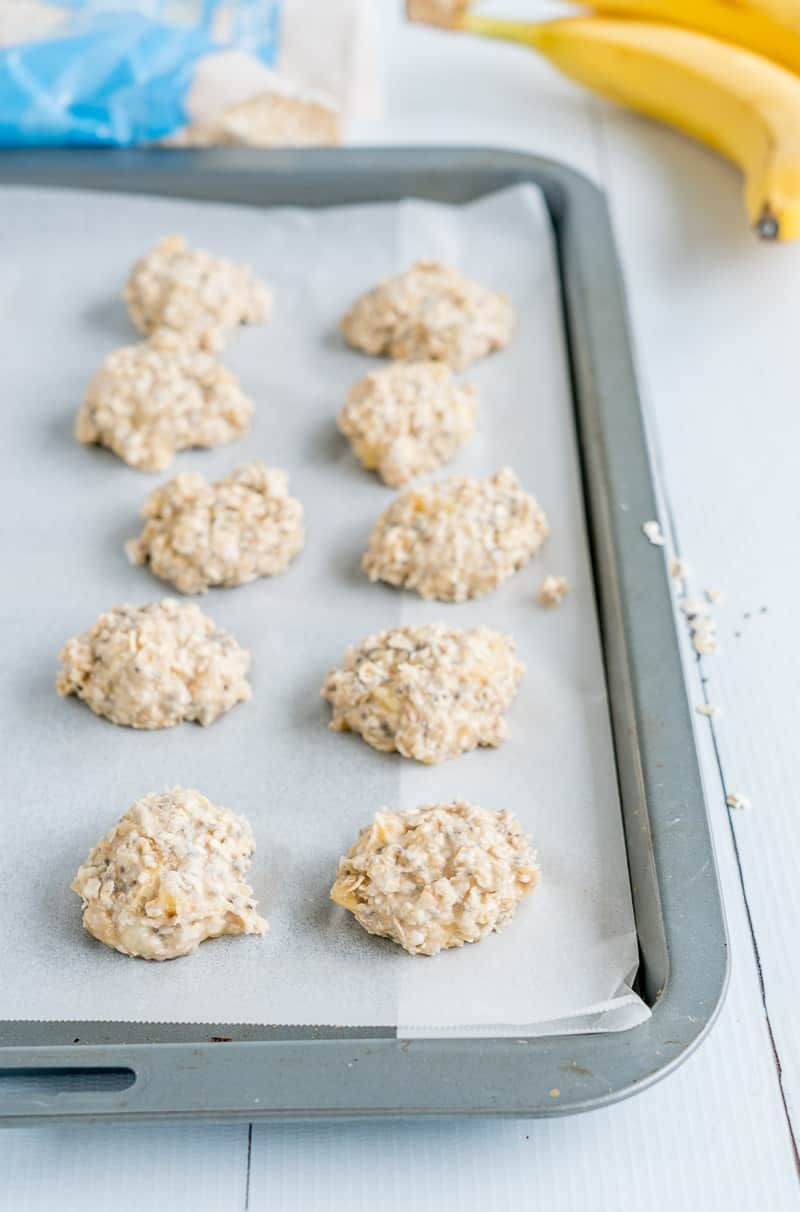 Banana oat baby cookies raw mixture on a baking tray