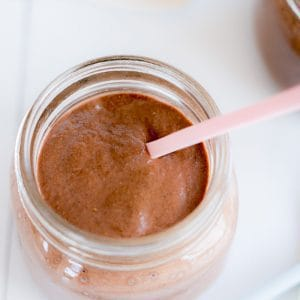 Chocolate chia pudding with a pink spoon