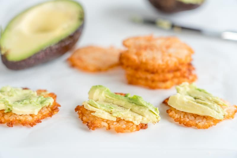 Homemade rice crackers topped with avocado