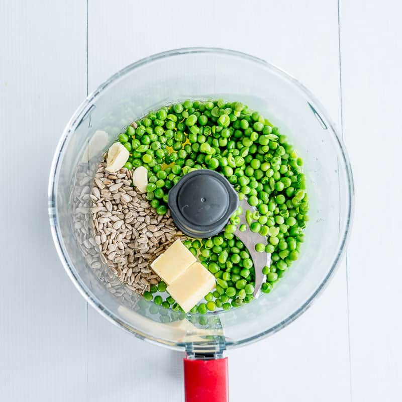 Pea pesto ingredients in a food processor