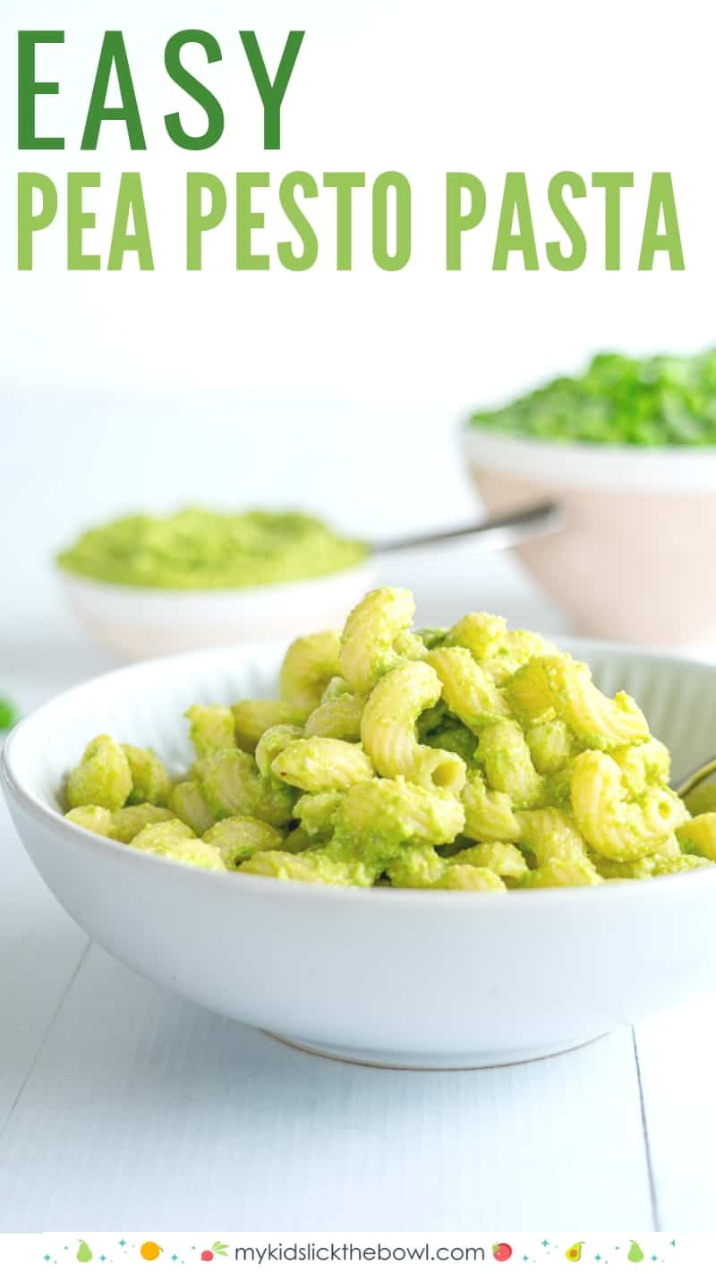 Pea pesto pasta in a white bowl with peas in the background