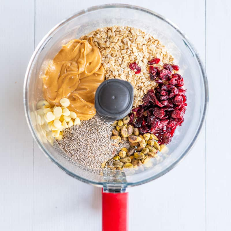 Cranberry Pistachio Energy bites ingredients in a food processor