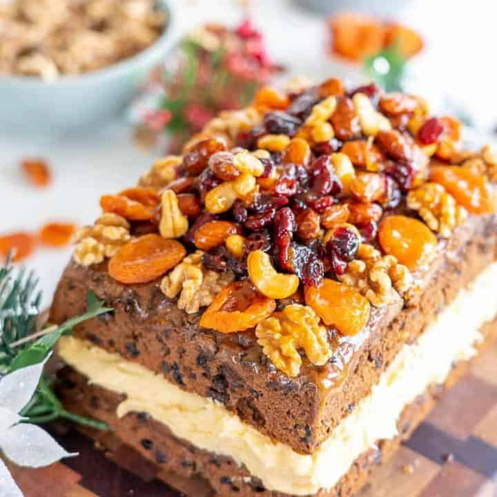 Christmas cake filled with buttercream and topped with a fruit and nut crust