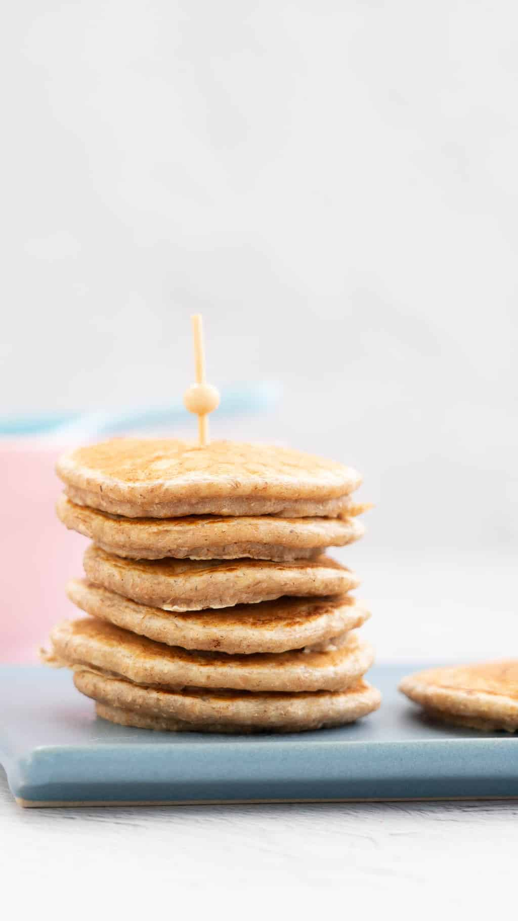 stack of wholemeal pikelets held together with a bamboo skewer
