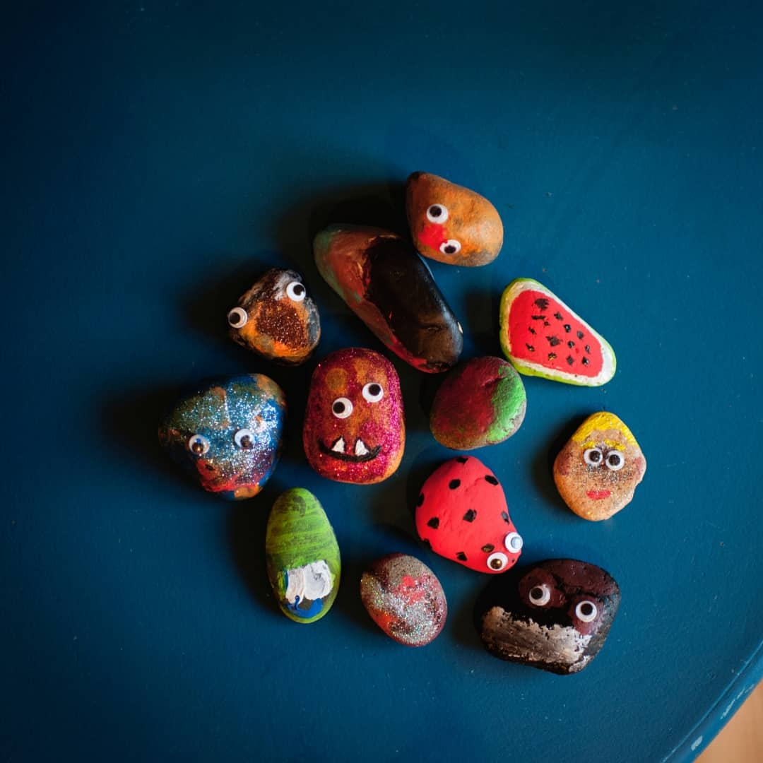 a collection of brightly painted rocks