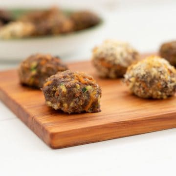 rissoles sitting on a wooden board