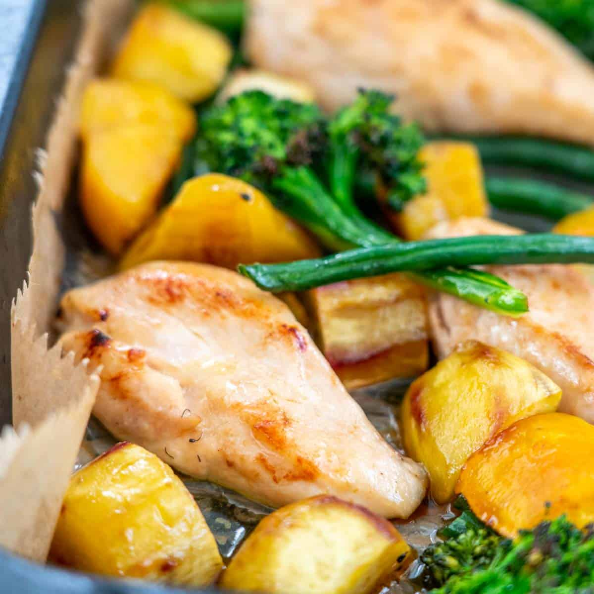 Chicken breast, sweet potato broccoli and beans baked with a maple caramel sauce in a large roasting dish