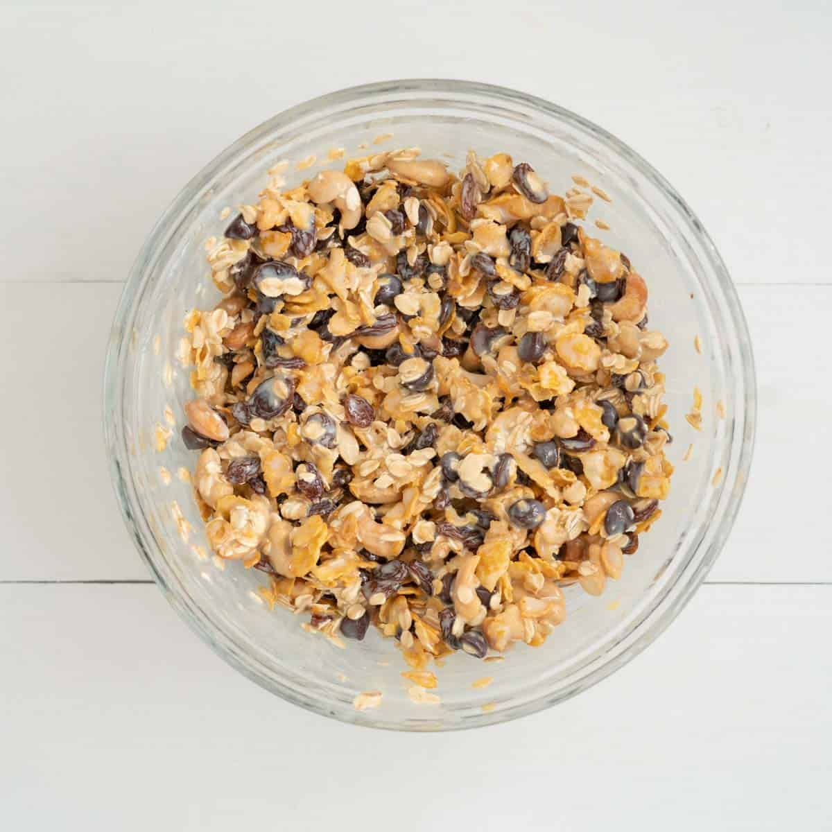 Cereal, nuts, dried fruits and chocolate drops mixed together in a bowl