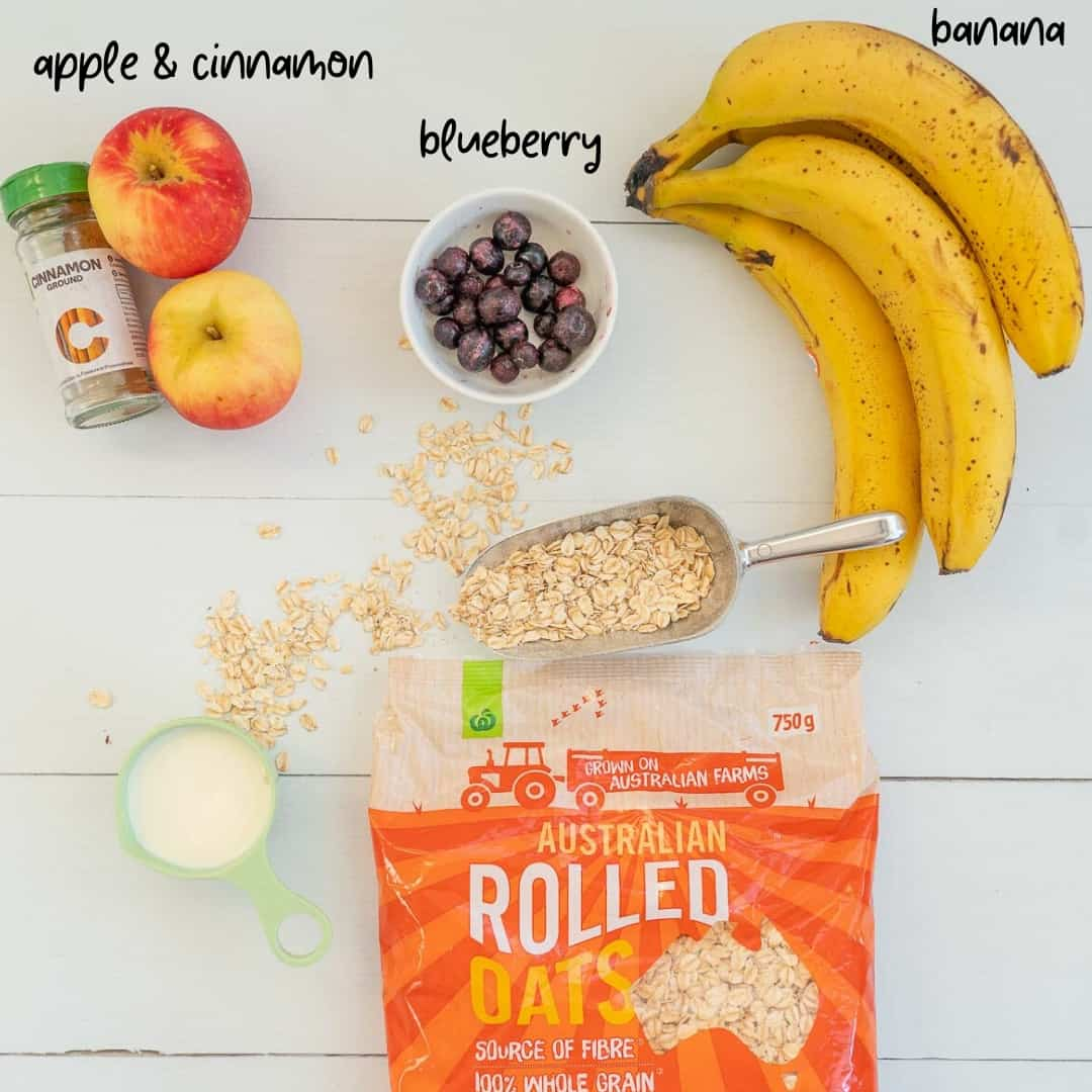 The ingredients for porridge fingers Rolled oats, milk, apple, cinnamon, blueberries ,banana