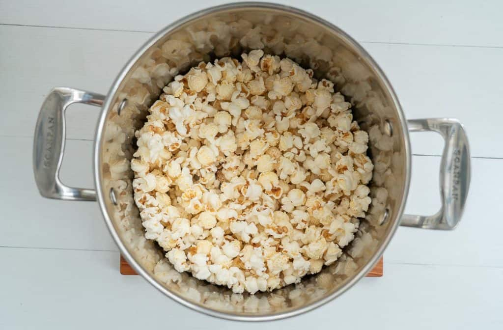 A large saucepan half full of popped popcorn