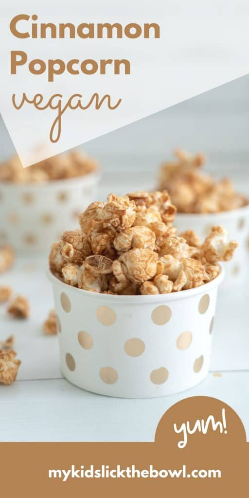 "Caramel coloured popcorn in a white and gold polka dot cup with text overlay ""Cinnamon Popcorn Vegan"""