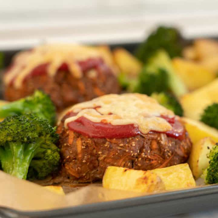meatloaf topped with tomato ketchup and grated cheese with roast potatoes and broccoli