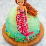 Ombre ocean coloured cake with a mermaid cake topper decorated with colourful sweets