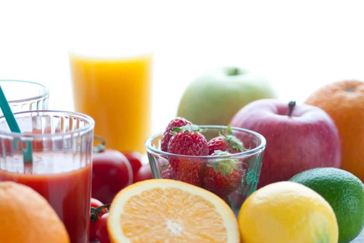 a collection of fresh fruit and fruit juices