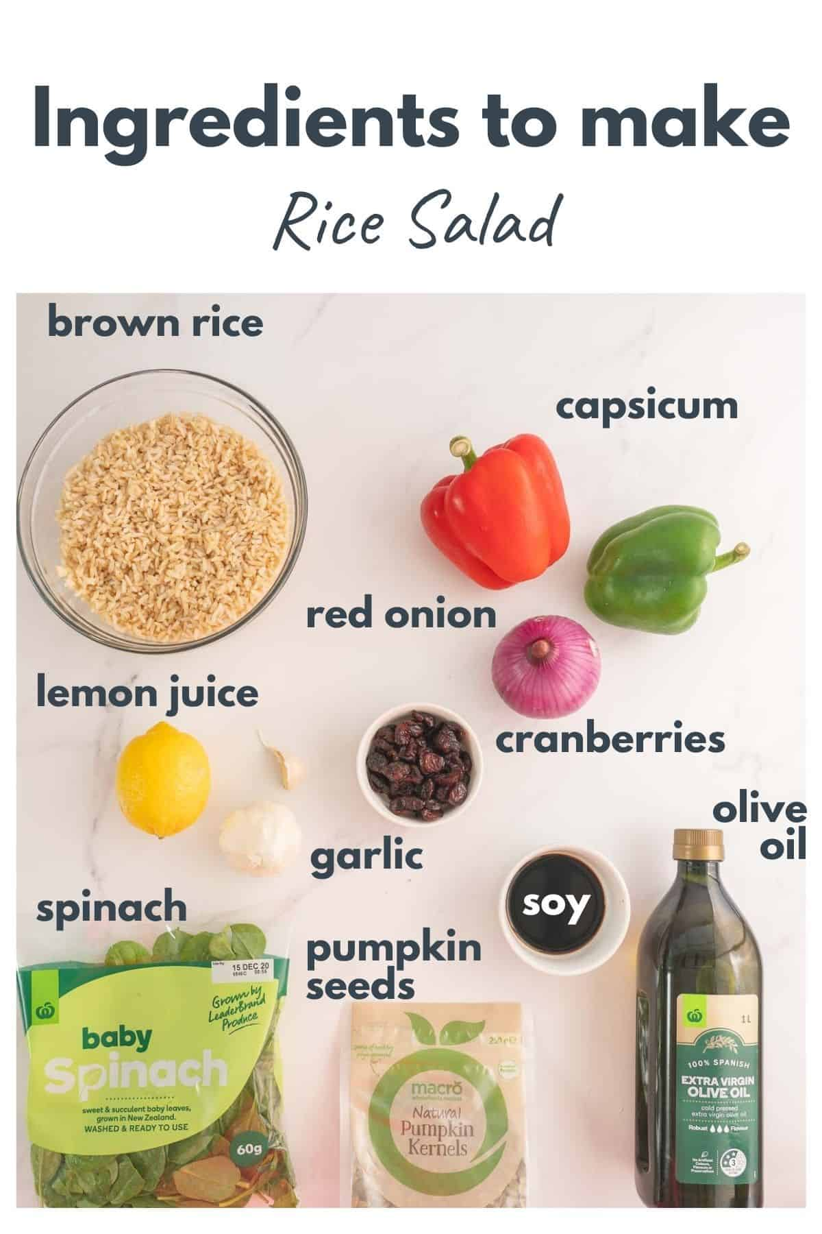 Ingredients to make a Christmas rice salad laid out on a bench top with text overlay.