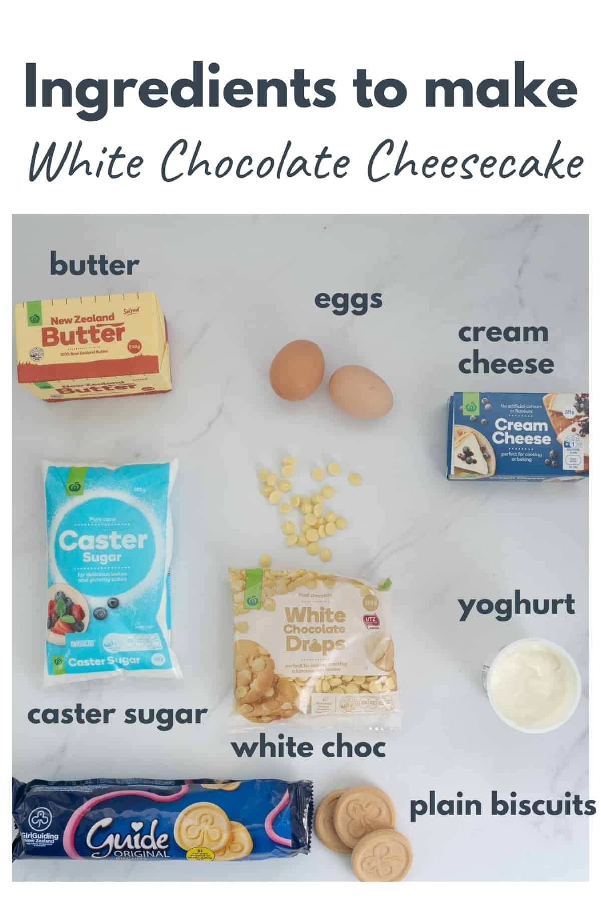 Ingredients to make a white chocolate cheese cake laid out on a bench top with text overlay.