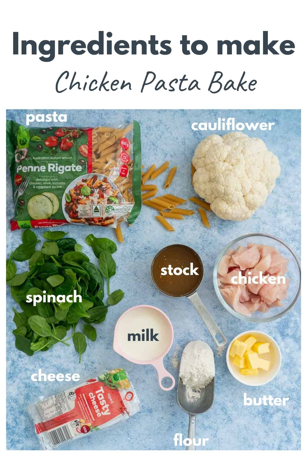 The ingredients to make chicken pasta bake laid out on a blue bench top with text overlay.