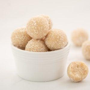 A small white bowl of coconut balls.