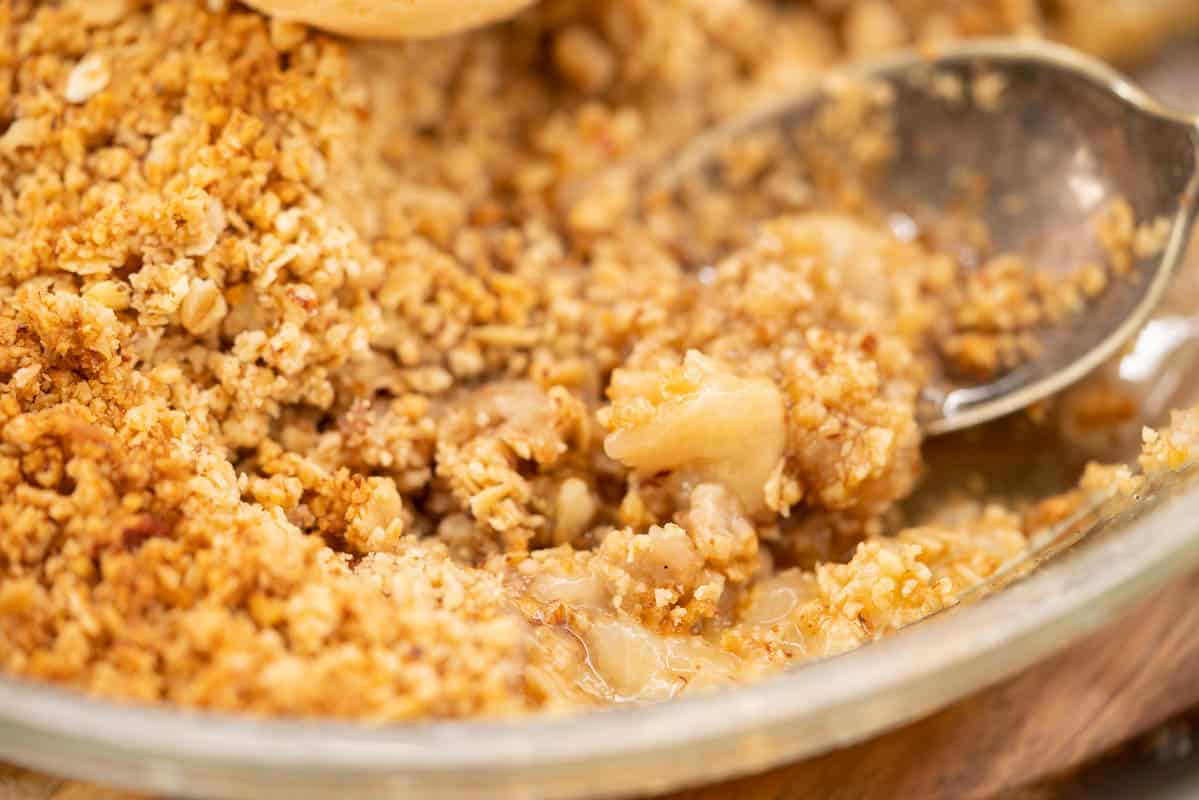 Close up of feijoa crumble, oats and feijoa flesh visible.