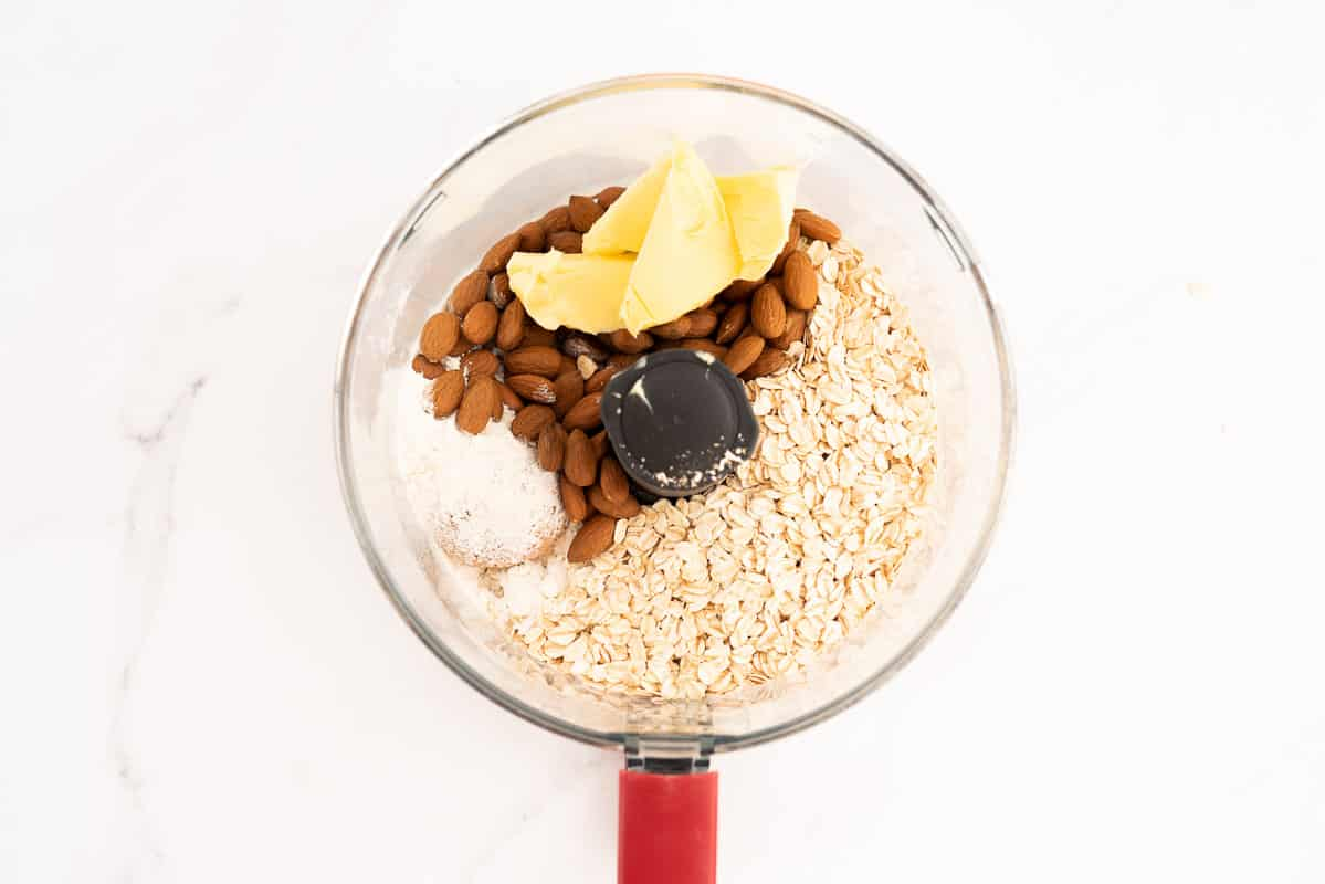Almonds, flour, brown sugar, and butter in a food processor.
