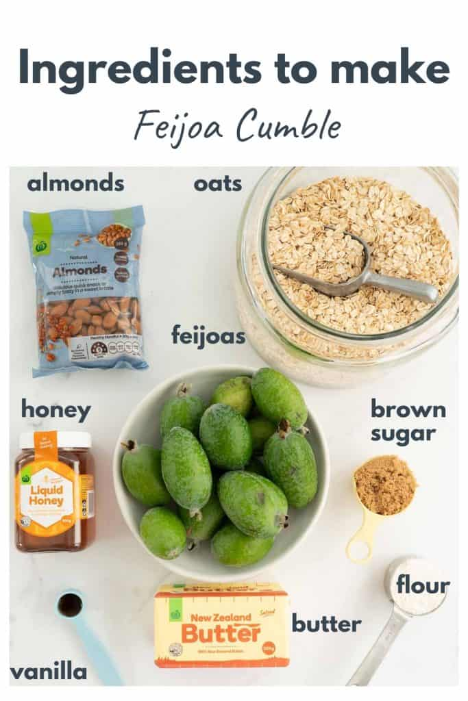 The ingredients to make feijoa crumble laid out on a bench top with text overlay.