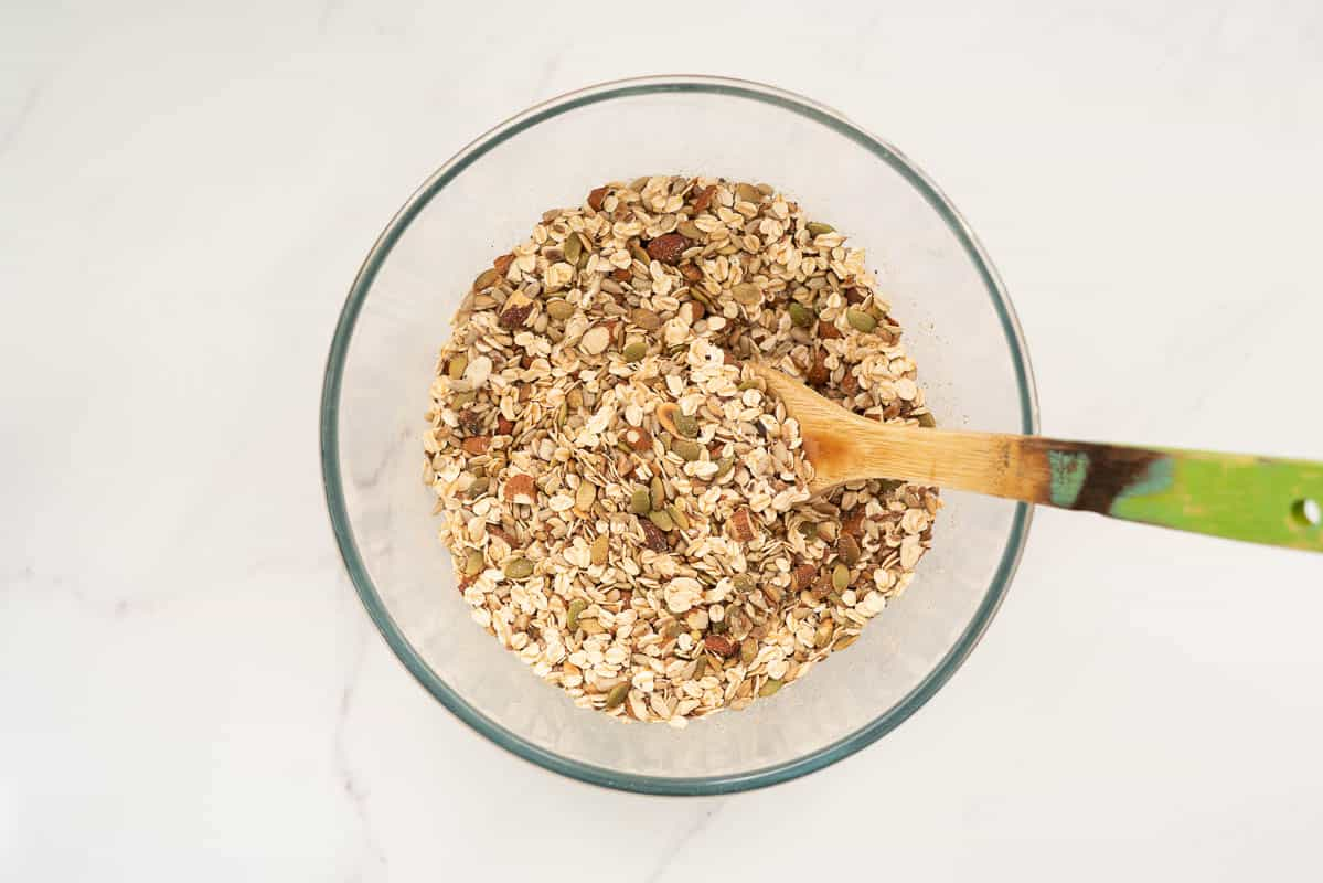 Nuts, seeds and rolled oats in a large mixing bowl.