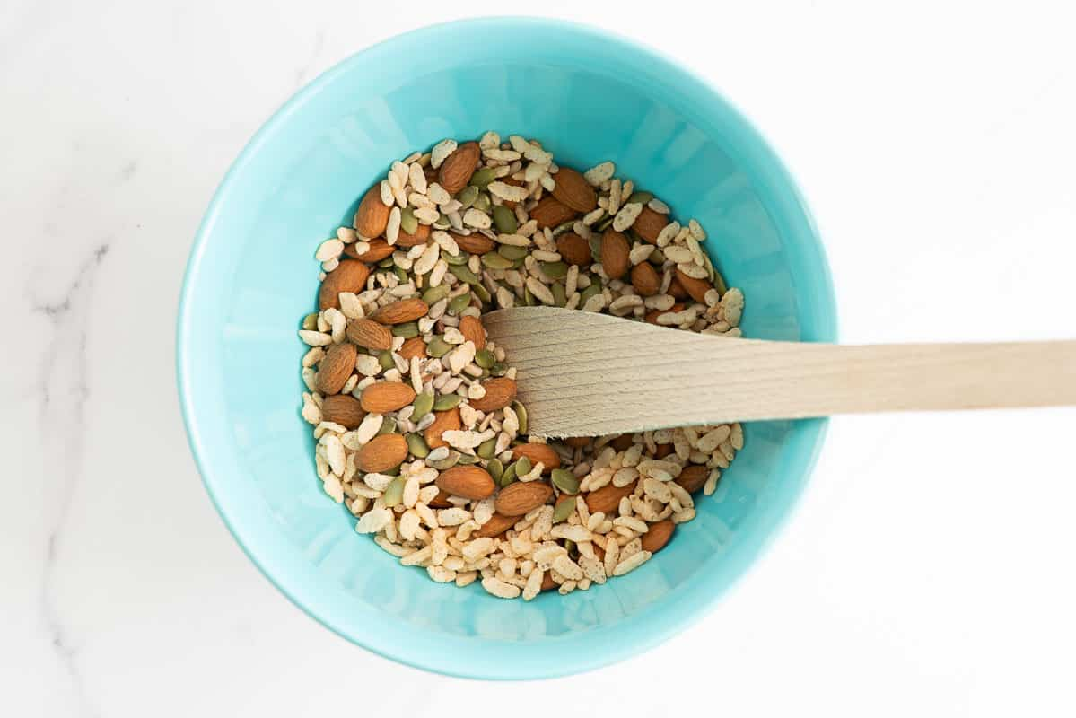 Nuts and seeds in a light blue mixing bowl.