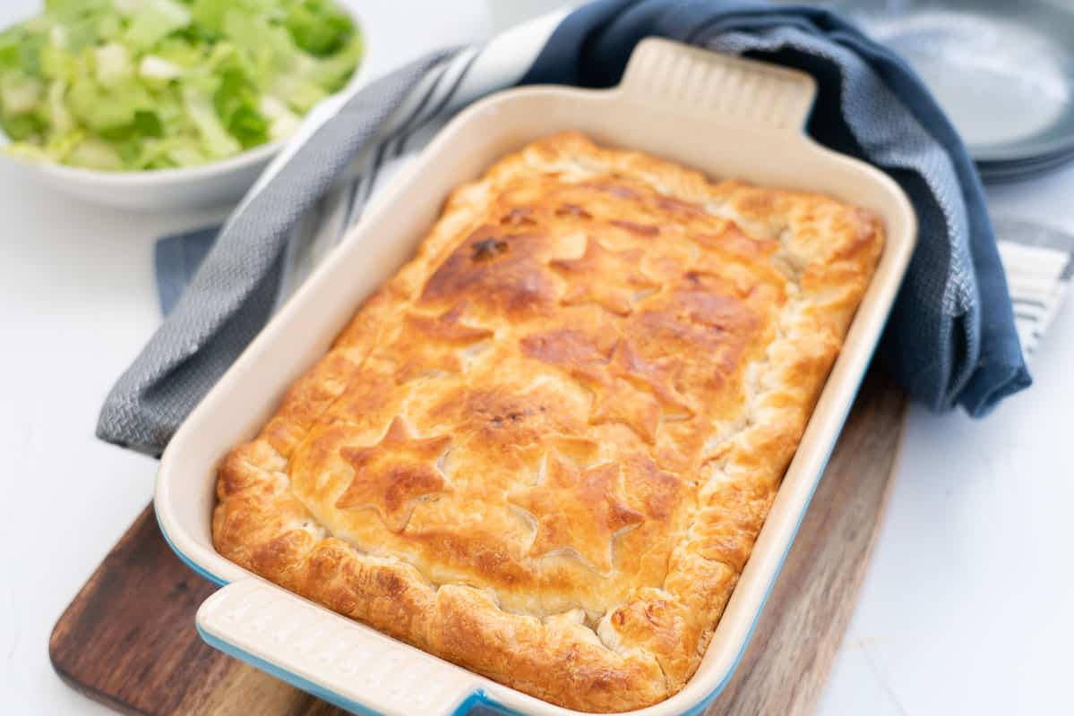 A golden baked bacon and egg pie topped with puff pastry stars.