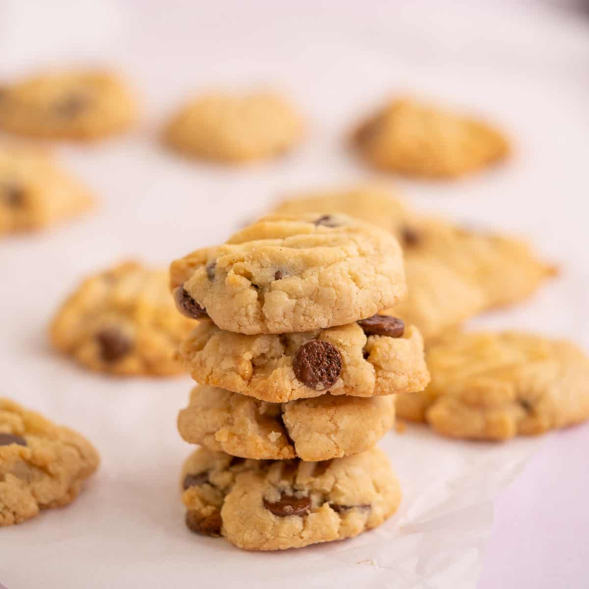 4 gluten free vegan chocolate chip cookies stacked in a tower.