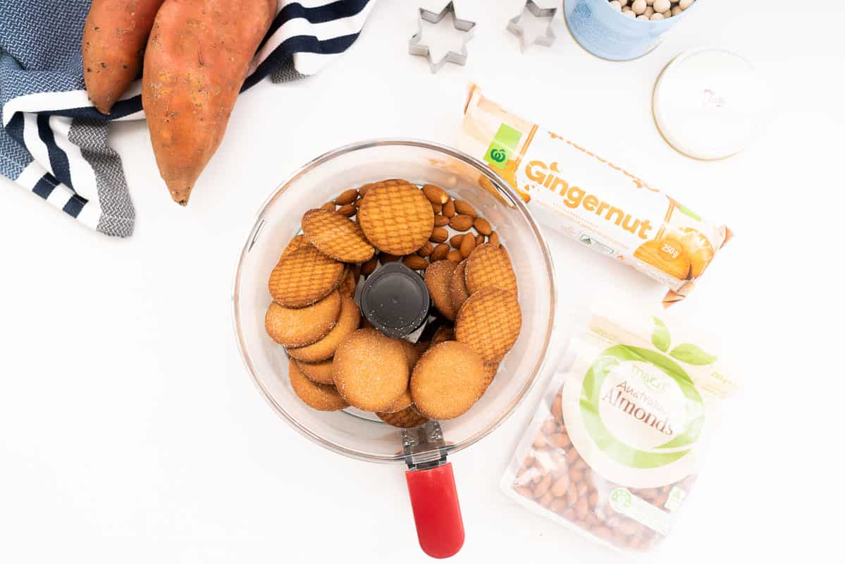 gingernut biscuits and almonds in a food processor