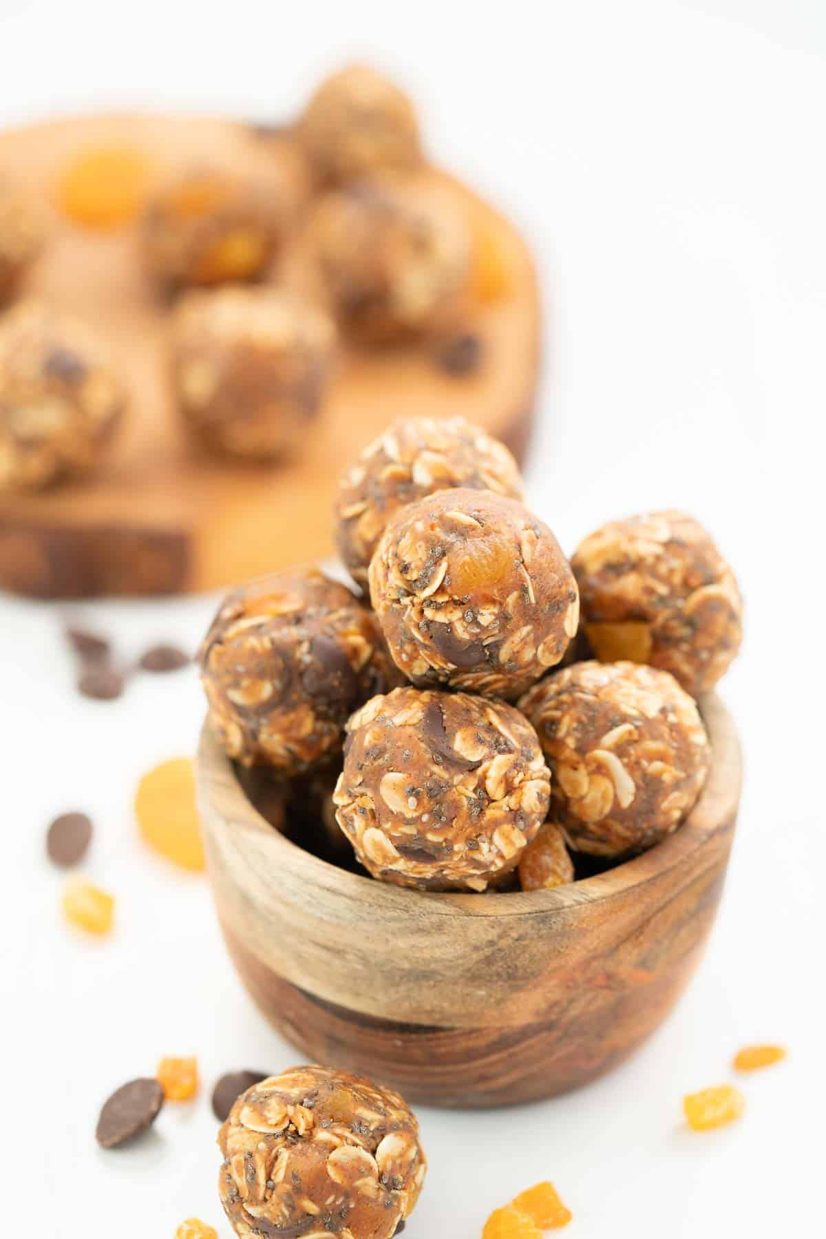A small wooden bowl of apricot oat balls.
