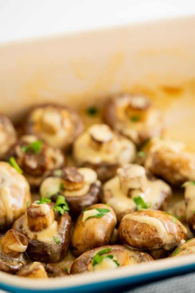 Mushrooms in a creamy sauce in a roasting dish.