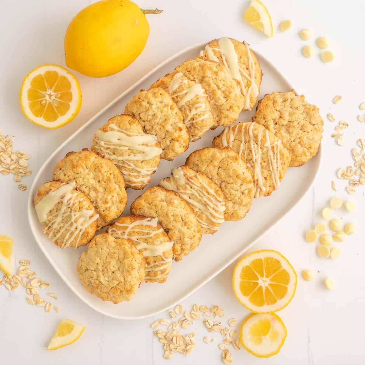 A white rectangular platter with 16 lemon oatmeal cookies.