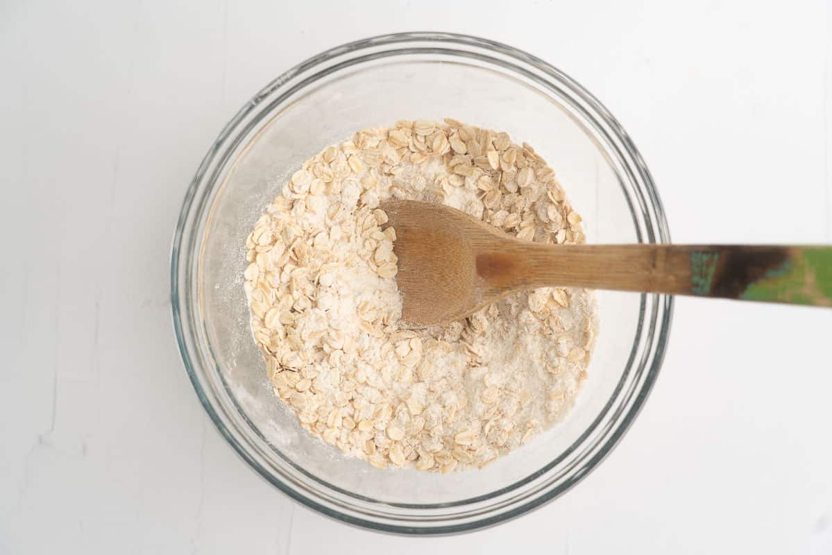 A glass mixing bowl and filled with dry ingredients.