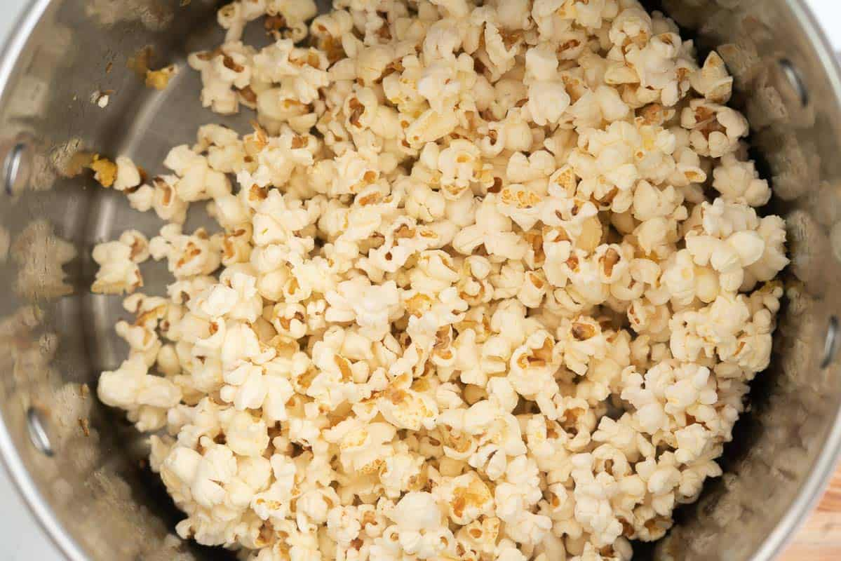 A large saucepan filled with popped popcorn.
