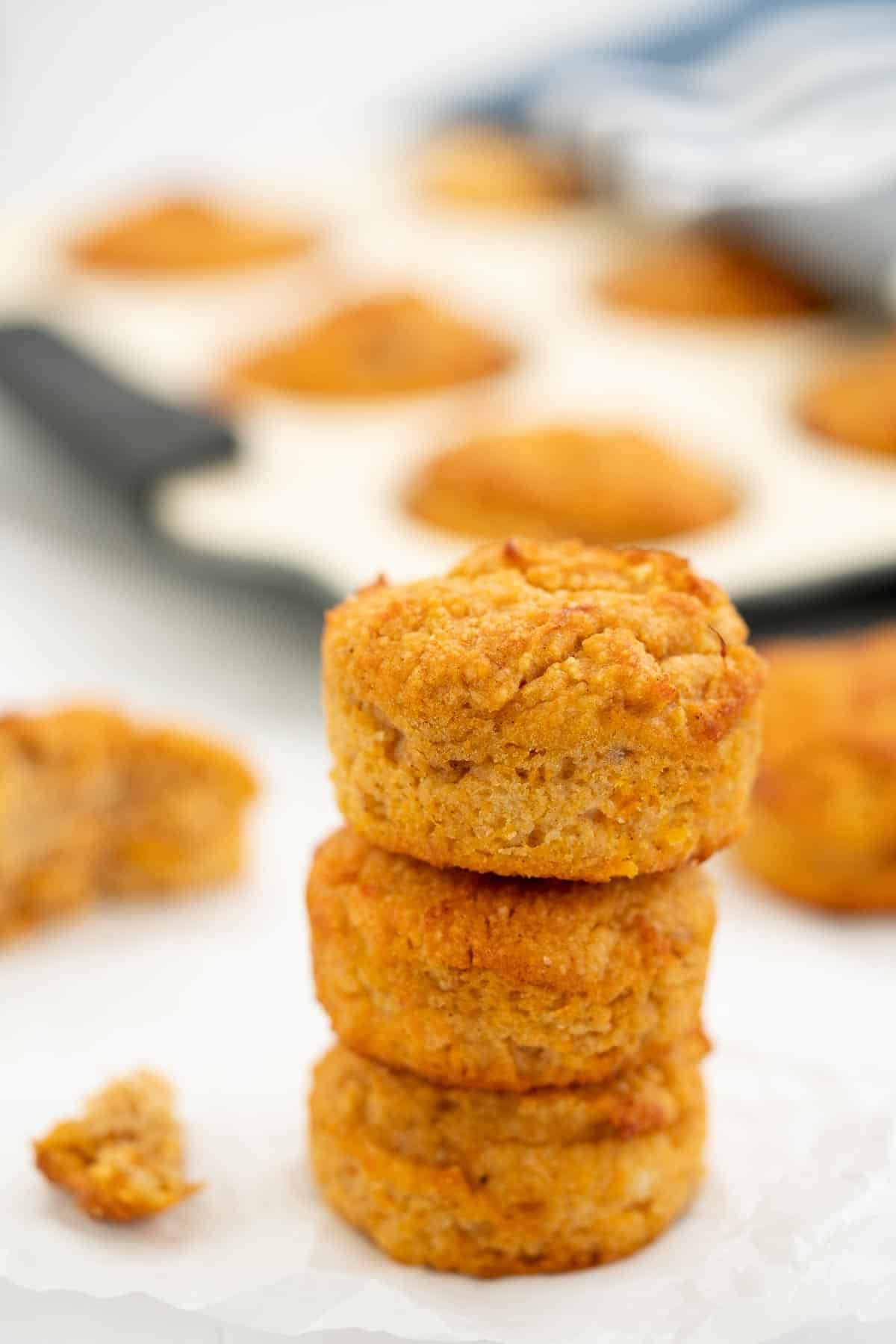A tower of three sweet potato muffins.