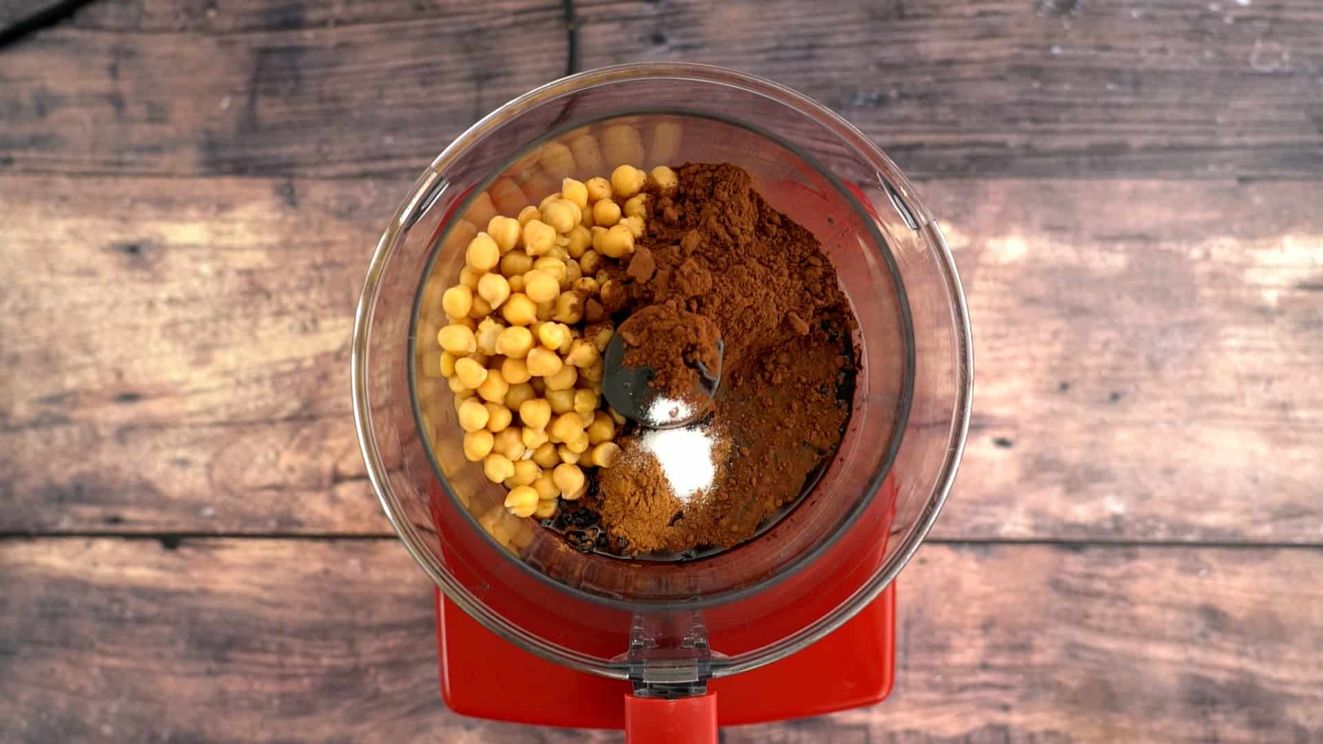 Chickpeas, cocoa, maple syrup in a food processor.