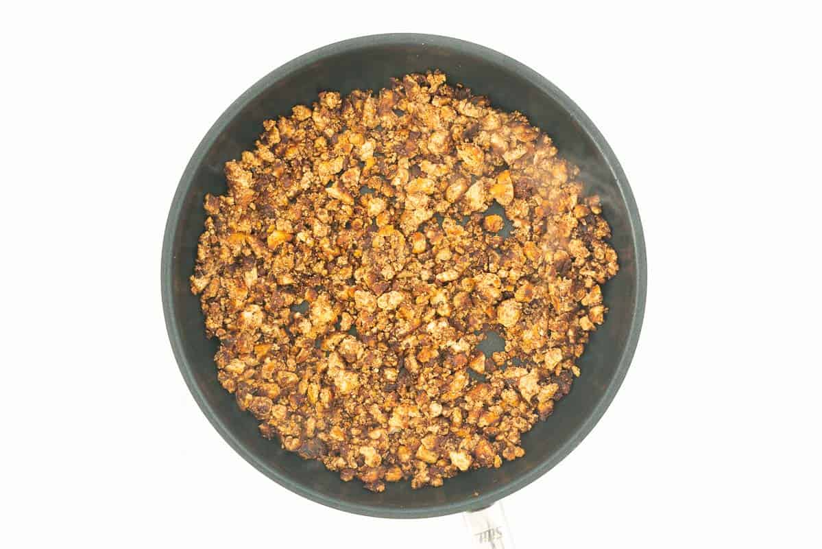 Browned Mexican tofu crumble in a fry pan.